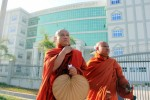 Utarra and a co-defendant leave the Eastern Rangoon District Court. (PHOTO: DVB)