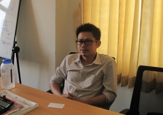 PACE executive director Sai Ye Kyaw Swar Myint reflects on the recent elections at his office in Rangoon on 7 December, 2015. (Photo: Phyo Thiha Cho / Myanmar Now)