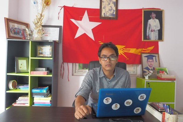 Nay Phone Latt, National League for Democracy MP elect for Rangoon Region parliament, works at his office in Thingangyun Township in early December. (Photo: Connor McDonald / Myanmar Now)