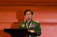The commander-in-chief of Burma's armed forces, Min Aung Hlaing, addresses Tuesday's opening of the Union Peace Conference in Naypyidaw.