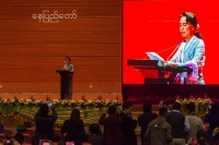 Aung San Suu Kyi addresses delegates on the first day of the Union Peace Conference in Naypyidaw. (PHOTO Ko Thet/DVB)