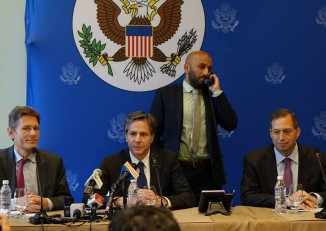A US State Dept aide speaks on a telephone behind  US Deputy Secretary of State Antony Blinken, ssistant Secretary of State for Democracy, Human Rights and Labor Tom Malinowski and Ambassador to Burma Derek Mitchell in Naypyidaw on Monday. (PHOTO:DVB)