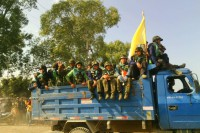 Members of Pat Ja San pictured travelling through Kachin State in a truck convoy. (PHOTO: Supplied)