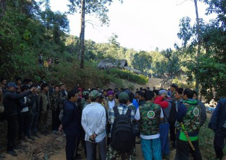 Pat Ja San members pictured in discussion with locals in Kachin State, 26 January 2016. (PHOTO: Supplied)