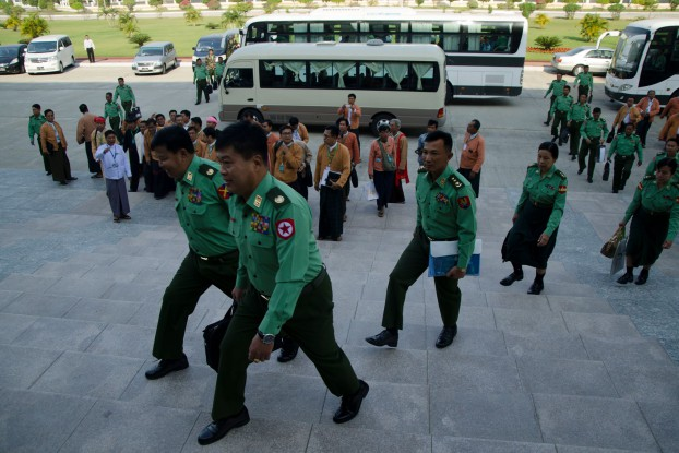 Military MPs lead National League for Democracy reps up the stairs towards Burma's parliamentary chambers in Naypyidaw. 1 February 2016. (PHOTO:DVB)
