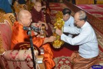 Former President Thein Sein (right) makes an offering to a senior Buddhist monk. (Photo: The President's Office)