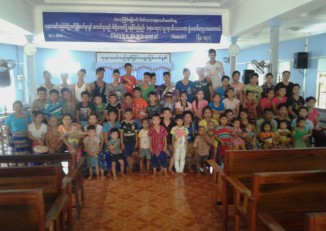 The 69 refugees who have left the Mae Ra Ma Luang refugee camp on the Thai-Burmese border pose for a photo at the church in Hpa-an, Karen State, where they are now sheltering. (Photo: DVB)