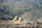 A bulldozer plows through a rice field to clear the way for an oil and gas pipeline in Arakan State. (Photo: Arakan Oil Watch)