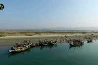 Fishing boats on the Naf River, which marks part of the border between Burma and Bangladesh (PHOTO: DVB)
