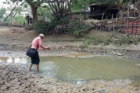A man steps across a dried-out pond in a village in Pegu Division. (Photo: DVB)