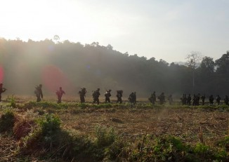 Arakan Army troops patrol territory under their control. (Photo: Arakan Army / Facebook)