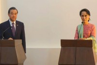 Chinese Foreign Minister Wang Yi, left, and NLD leader Aung San Suu Kyi appear at a press conference in Naypyidaw on 5 April 2016. (Photo: DVB)