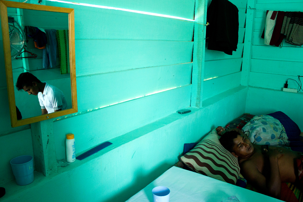 Rohingya refugees take some rest in their room at Timbang Refugee Camp, in the outskirts of Langsa City (Aceh Province, Indonesia). Photo: Carlos Sardiña Galache / Yayasan Geutanyoe – A Foundation for Aceh.