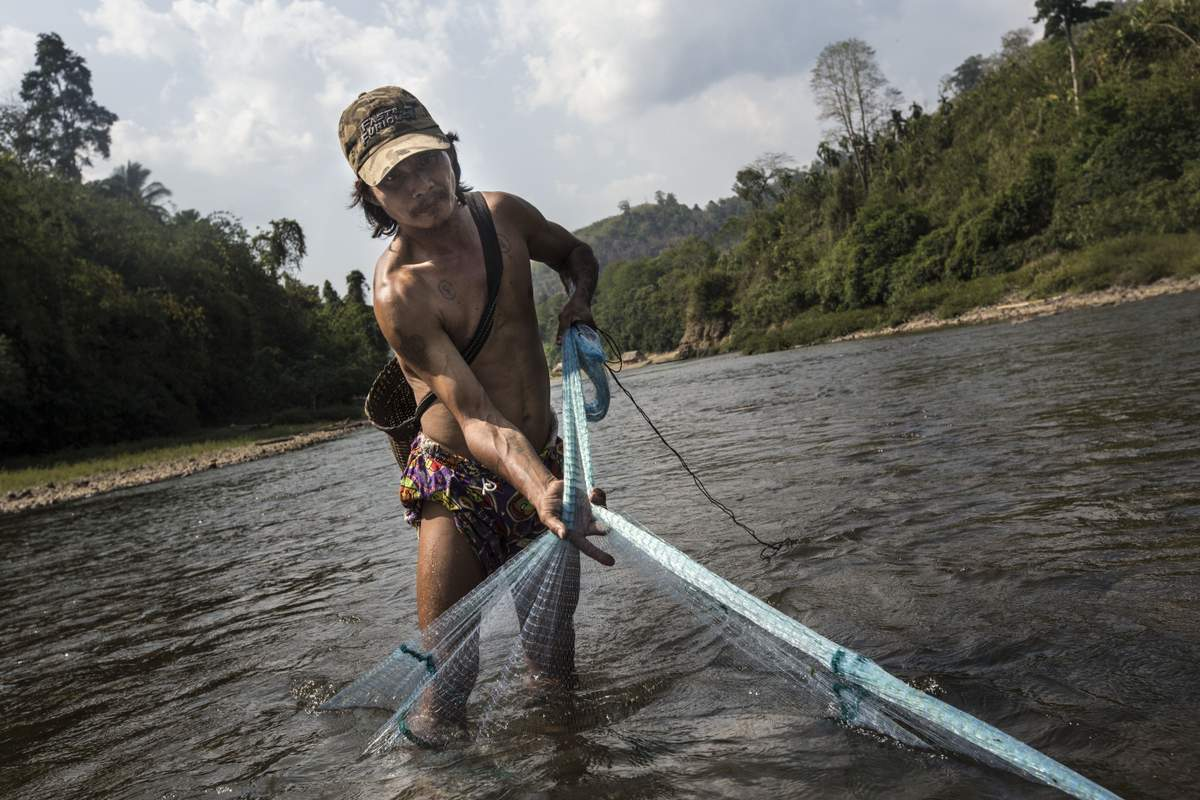 An ethnic Karen fisherman pulls in his fishing net in the Banchaung river. This photo is part of the Human. Nature. exhibition at Rangoon's Myanmar Deitta Gallery from 20 May to 3 June, 2016. (Photo: Minzayar)