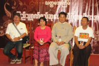 Dr. Than Min Htut, a medical doctor, has been announced as the grand prize recipient of the 2016 Citizen of Burma Award. He sits on stage with the other prize recipients. (Photo: Citizen of Burma)