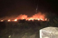 A squatter settlement in Wadatkwin, a village in Mon State's Kyaikhto Township, being burned down, allegedly on orders from local authorities.