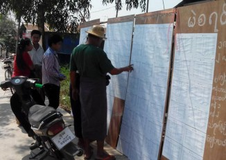People check their names on voter registration lists in this file photo from 2015. (Photo: Let's Go Vote)