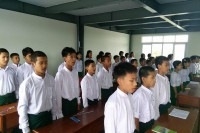 Students at a Rangoon school founded by nationalist Buddhist monks began their class by singing Burma's national anthem on Wednesday. (Photo: Mahaw Thadar High School)