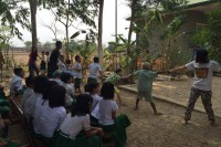 The Myanmar Story Tellers performing a folklore story with the help of audience members at a school. (Photo: The Myanmar Story Tellers / Facebook)