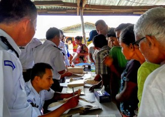 Residents of Kyaukphyu Township in Arakan State line up to show their documents to immigration officials on 8 June 2016. (Photo: DVB)