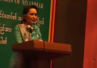 DVB TV screen grab of Aung San Suu Kyi addressing migrant workers in the Thai port town of Mahachai on 23 June 2016.