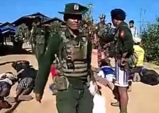 Screenshot of a video showing Burmese army troops and members of a local militia group allied to the Burmese military torturing villagers in Shan State's Namkhan Township in December 2015. (Palaung State Liberation Front)
