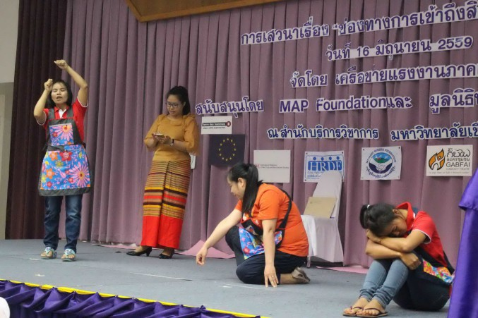 Burmese domestic workers stage a performance reconstructing their average working day in Thailand. Chiang Mai, 16 June 2016 (PHOTO: Libby Hogan/DVB)