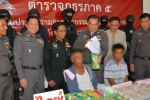 Former WNO deputy-chairman Ta Maha (sitting, left, blue jacket) is detained at police station in northern Thailand on drug trafficking charges. (PHOTO: Thai Rath)
