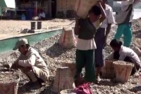 Child carry baskets filled with gravel at a building site in Rangoon. (Photo: DVB)
