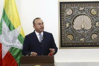 Turkish Foreign Minister Mevlut Cavusoglu speaks at a joint press conference after meeting with his Burmese counterpart Aung San Suu Kyi in Naypyidaw on 13 June 2016. (PHOTO: Anadolu Agency)