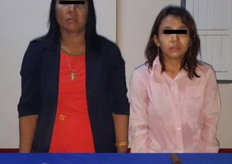 Schoolteacher Aye Aye Maw  (left) and her adopted daughter Kyawt Kay Khine were arrested on 20 June for the brutal murder of Khin Mya Win, 53, at her apartment in eastern Rangoon. (PHOTO supplied by Thingangyun township  police)