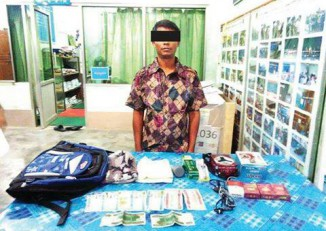 Suspect Ba Sein poses in front of his possessions after his arrest on charges of illegally entering Burma on 8 July 2016. (Photo: MOI)