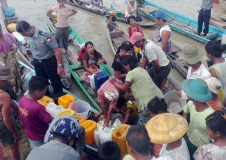Villagers in Sagaing Division collect drinking water amid shortages caused by recent flooding. (Photo: DVB)