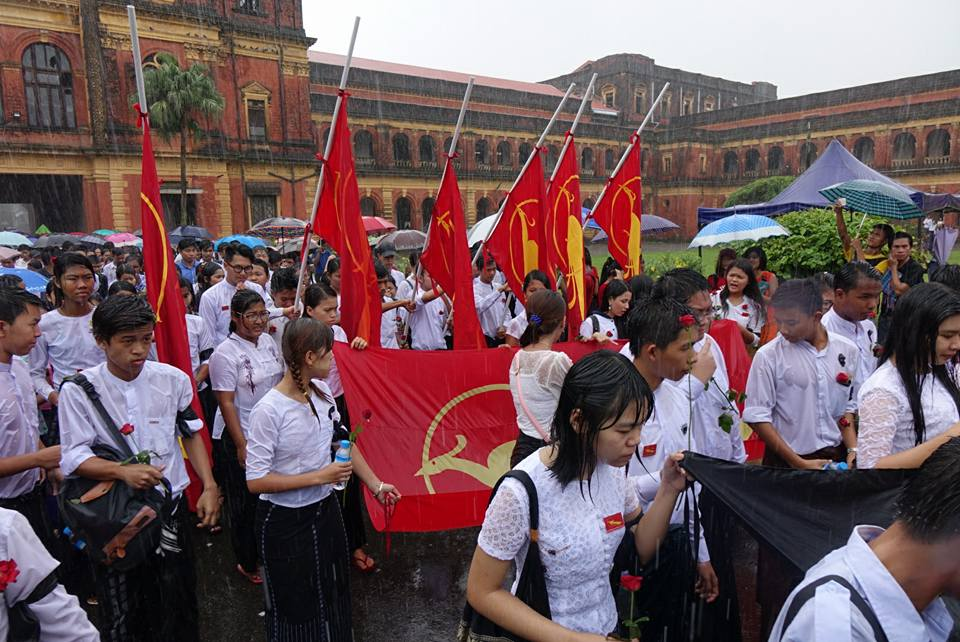 Students march in the rain in Rangoon to mark Martyrs' Day on 19 June 2016.
