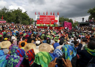 Aung San Suu Kyi made promises of peace a central platform of the NLD's election campaign. Here she is seen addressing a crowd, mainly made up of ethnic peoples, at a rally in Shan State in September 2015. (Photo: Reuters)