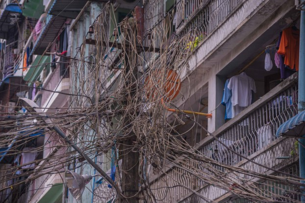 Tangled power lines are a common sight in Burma's largest city. (Photo: Aung Naing Soe / Coconuts Yangon)