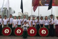 Children stand at attention at a vigil to commemorate the 8888 uprising. (Photo: DVB)