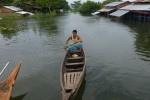 A resident of Sankin Island in the Irrawaddy delta rows a boat through his inundated village. (Photo: DVB)