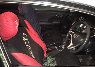 The window of filmmaker Aung Myat's car was smashed and a bag containing valuable computer equipment was stolen. (Photo: DVB)
