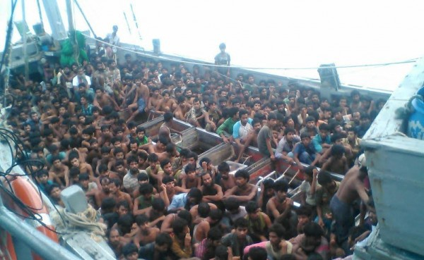 A boat holding hundreds of migrants is detained by the Burmese navy in Irrawaddy Division in May 2015. (Photo: Ministry of Information)
