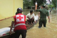 Emergency response teams from the Myanmar Red Cross come to the assistance of flooding victims in August 2015. (Photo: ICRC)