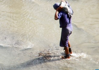 A prisoner shackled on both of his legs carries a granite stone at a rock quarry run by the prison department in Paung Township in Mon State. (Photo: Swe Win / Myanmar Now)