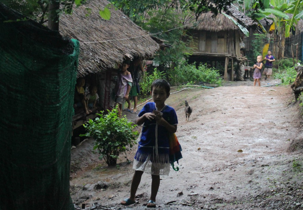 A child leading his home to walk to school. (Photo: Libby Hogan / DVB)