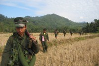 FILE PHOTO: TNLA troops march across a field in Shan State. The TNLA is one of three groups that were previously excluded from peace talks in Burma. (Photo: TNLA)