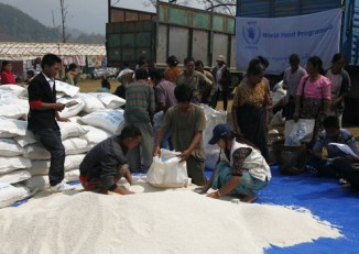 UN staff distribute food to people displaced by fighting in Kachin State. Natural disasters and a long history of conflict have created a need for a strong tradition of humanitarian relief work in Burma. (Photo: WPN)