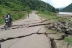 A motorcyclist navigates across a giant crack in the road near Kalewa, Sagaing Division, on 10 August 2016. (PHOTO: DVB)