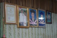 Family photos adorn the wall of Soe Naung's home in Rangoon. (PHOTO: Ko Arkar/DVB)