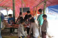 Children study at a camp for Kokang refugees in China's Yunnan Province. (Photo: DVB)
