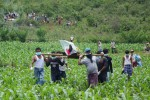 Family members and villagers carry the body of one of five young men killed by Burmese soldiers in the village tract of Mong Yaw, in Shan State's Lashio Township, in late  June 2016. (Photo: DVB)