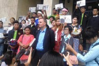 Migrant rights activist Andy Hall appears with supporters in front of a courthouse in Bangkok after being found guilty of defaming a Thai fruit exporter. (Photo: Andy Hall / Facebook)